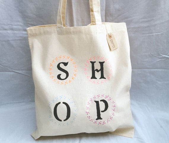 A Natural Cotton Tote Shoulder Bag with a Multi-Colour Shop Design