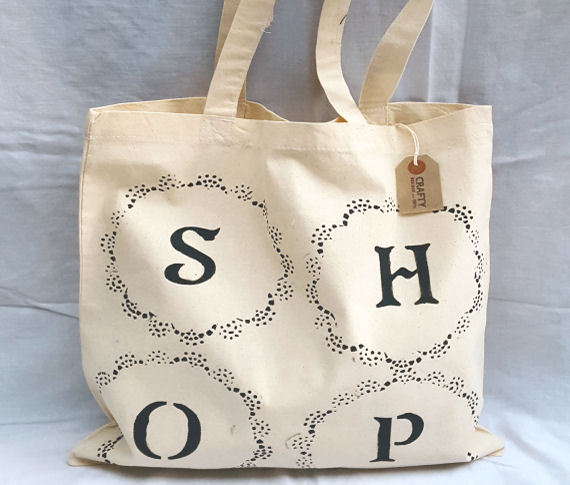 A Natural Cotton Tote Shoulder Bag with a Circular Pattern Shop Design in Black