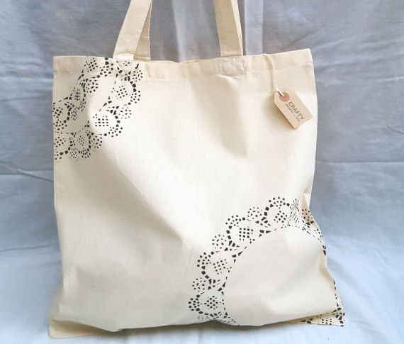 A Natural Cotton Tote Shoulder Bag with a Black Pattern design