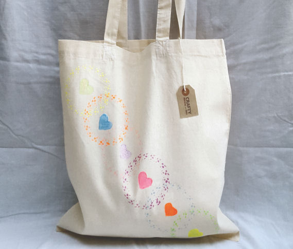 A Natural Cotton Tote Shoulder Bag with a Circle and Heart Rainbow Effect Pattern Design