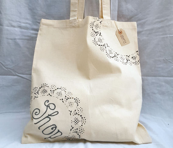 A Natural Cotton Tote Shoulder Bag with a Shop and Black Pattern Design