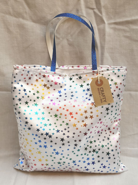 A Multi-Colour Gift Bag with Blue Glitter Handles