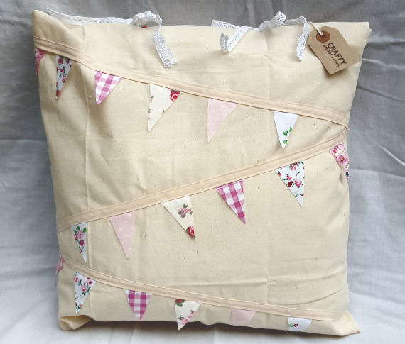 Natural Calico Cushion with a Pink Bunting Design