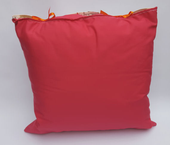 A Handmade Home Garden Design Cushion with Pink reverse and Orange Bows