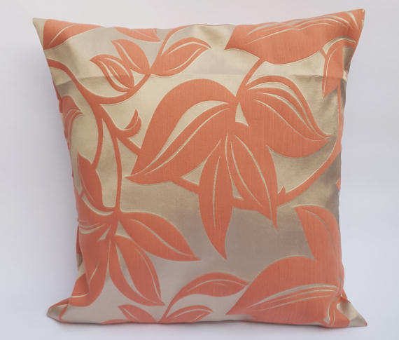 A Handmade Floral Cushion in Coral on Beige.