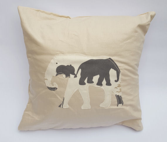 A Handmade Elephant Stencil Design Cushion on Light Beige