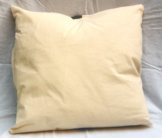 A Natural Calico Cushion with a Bow Design