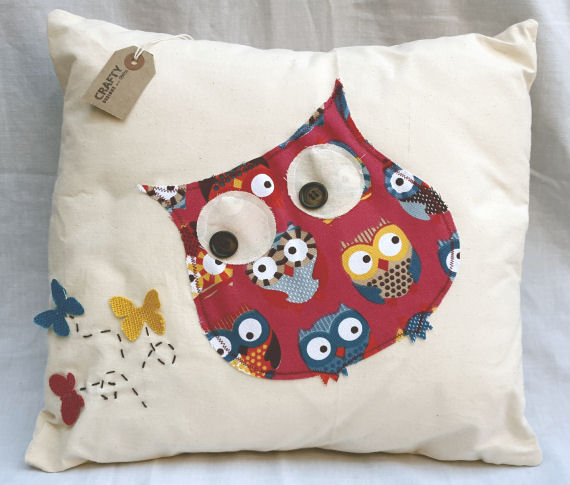 A Natural Calico Cushion with an Owl and Butterfly Design finished with an Envelope Style Reverse