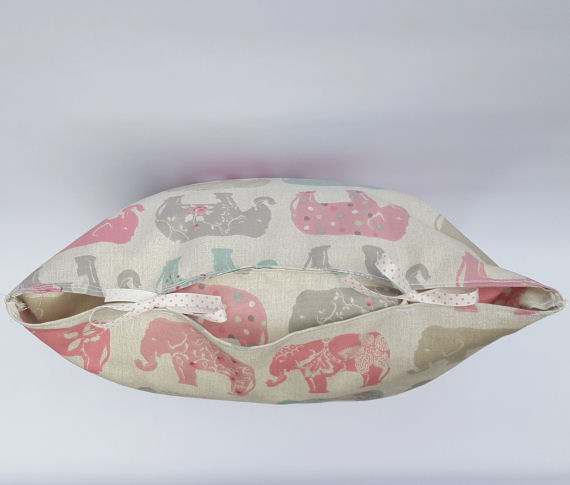 Handmade Pastel Coloured Elephant Design Cushion on Light Beige with Bows