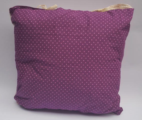 A Floral Pattern Cushion on Cream with a Purple Reverse with Spots, finished with Bows