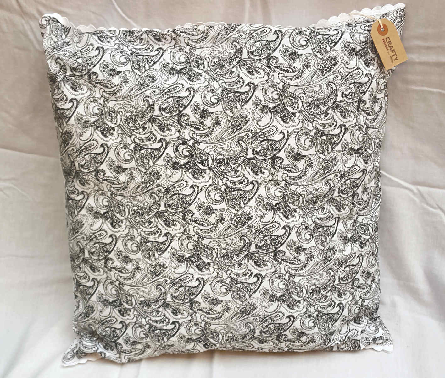 black pattern spot design cushion on white with buttons handmade soft furnishings shops. Black Bedroom Furniture Sets. Home Design Ideas