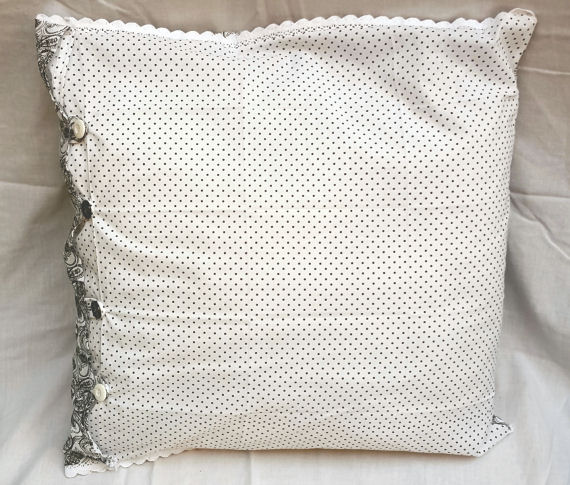 Black Patterned and Spotted Cushion on White with Buttons